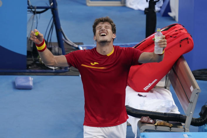 Pablo Carreno Busta, of Spain, celebrates after defeating Novak Djokovic, of Serbia, in the bronze medal match of the tennis competition at the 2020 Summer Olympics, Saturday, July 31, 2021, in Tokyo, Japan. (AP Photo/Seth Wenig)