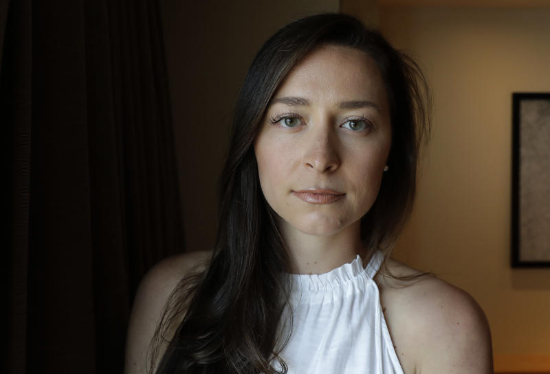 Olympic swimmer Ariana Kukors Smith poses for a photo, Monday, May 21, 2018, before an Associated Press interview in Seattle. Kukors Smith sued USA Swimming on Monday, alleging the sport's national governing body knew her former coach sexually abused her as a minor and covered it up. (AP Photo/Ted S. Warren)