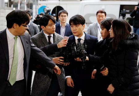 Seungri, a member of South Korean K-pop band Big Bang, arrives to be questioned over a sex bribery case at the Seoul Metropolitan Police Agency in Seoul, South Korea, March 14, 2019.   REUTERS/Kim Hong-Ji/Files