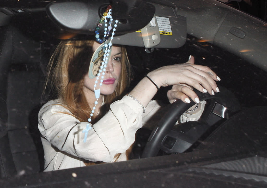 Lindsay Lohan and her friend were pulled over by police after the actress reportedly grazed a person standing near her car as she attemped to leave the Sayers Club in Hollywood early Wednesday morning.  Lohan's friend took the wheel after the incident on Wednesday, March 14, 2012 X17online.com EXCLUSIVE