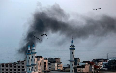 Smoke rises after an Israeli strike in northern Gaza - Credit: Photo by MAHMUD HAMS/AFP via Getty Images