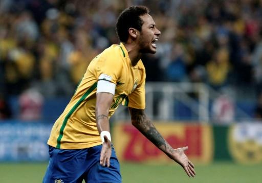 Neymar celebrates after scoring in a qualifier against Paraguay last year