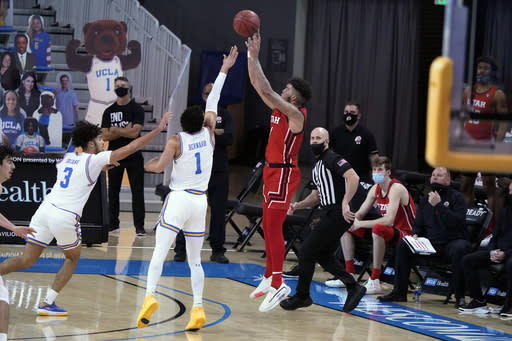 Utah forward Timmy Allen shoots over UCLA guard Jules Bernard (1) during the second half of an NCAA college basketball game Thursday, Dec. 31, 2020, in Los Angeles. (AP Photo/Marcio Jose Sanchez)