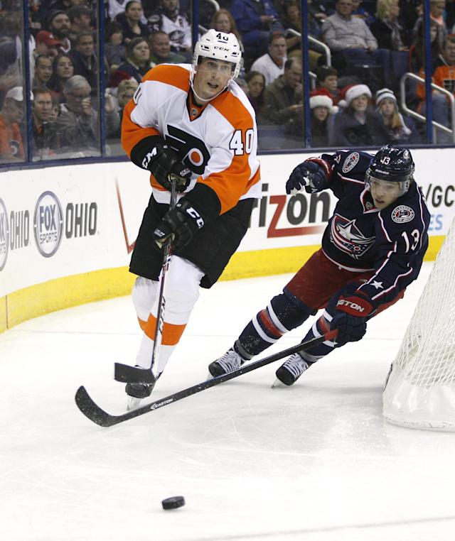 Columbus Blue Jackets' Cam Atkinson (13) chases Philadelphia Flyers' Vincent Lecavlier (40) during the second period of an NHL hockey game on Saturday, Dec. 21, 2013, in Columbus, Ohio. (AP Photo/Mike Munden)