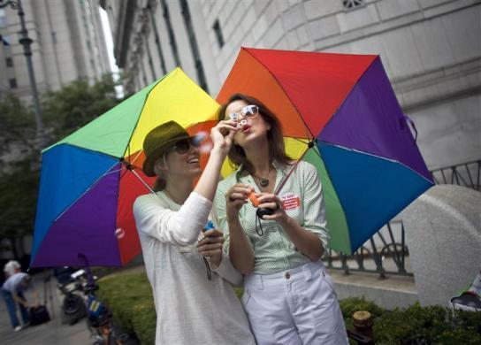 "Cat Yezbak (L) and Rachel Priebe blow bubbles outside the Manhattan City Clerk's office July 24, 2011.Thousands of gay and lesbian New Yorkers are getting ready to say ""I do"" this weekend, as the Empire State becomes the sixth in the U.S. to embrace same-sex marriage."
