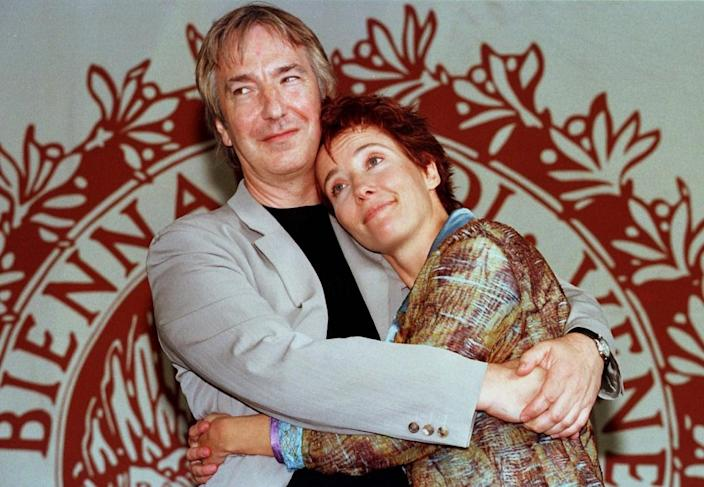 British actor and director Alan Rickman embraces actress Emma Thompson in front of the Leone d'Oro at the 54th Venice Cinema Festival in 1997 (AFP Photo/Claudio Onorati)