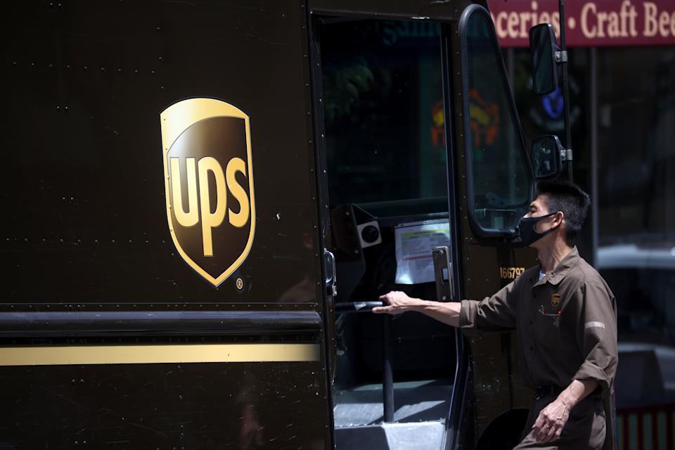 SAN FRANCISCO, CALIFORNIA - JULY 30: A United Parcel Service (UPS) driver gets into his truck while on his delivery route on July 30, 2020 in San Francisco, California. UPS reported a 13.4 percent surge in quarterly revenues to $20.46 billion beating analysts estimates of $17.48 billion. The global shipping company's net income rose 4.7% to $1.77 billion for the quarter.  (Photo by Justin Sullivan/Getty Images)