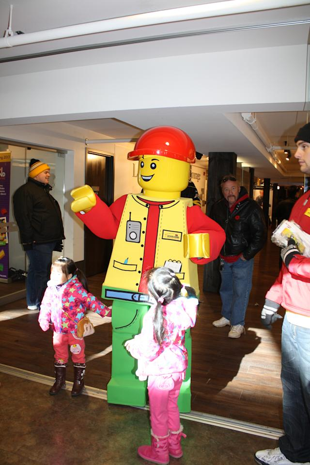 A giant LEGOMAN poses with children during the competition.