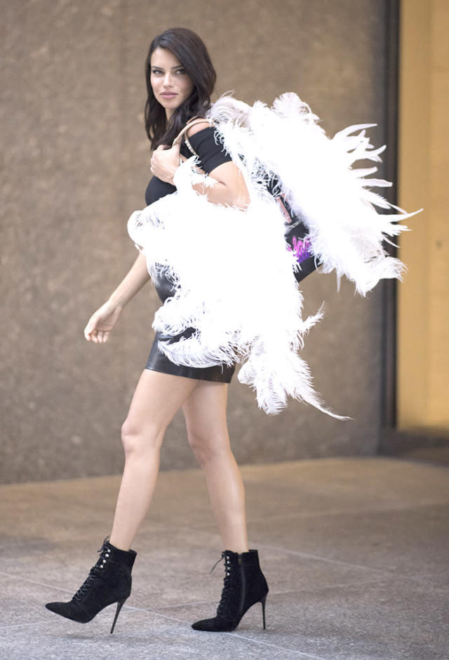 <p>The model reminded us that the Victoria's Secret Fashion Show is coming soon, when she brought her wings to a fitting for the annual spectacle. (Photo: Timur Emek/GC Images) </p>