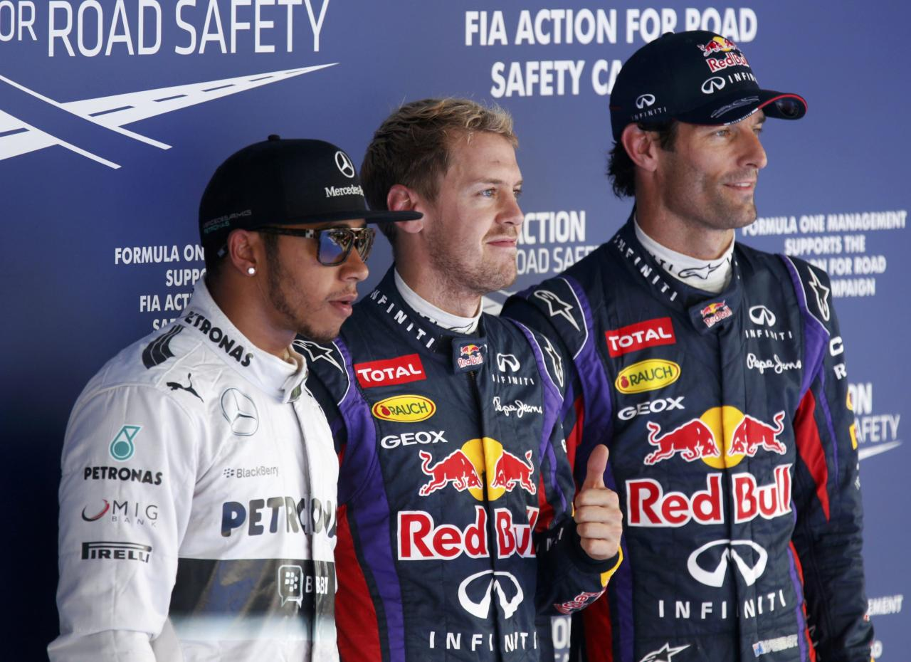 Red Bull Formula One driver Sebastian Vettel of Germany (C) gives a thumbs up after taking pole position as he poses with Mercedes Formula One driver Lewis Hamilton of Britain (L) and Red Bull Formula One driver Mark Webber of Australia after the qualifying session for the Korean F1 Grand Prix at the Korea International Circuit in Yeongam, October 5, 2013. Formula One championship leader Vettel will start Sunday's Korean Grand Prix on pole position for Red Bull with Hamilton's Mercedes alongside on the front row. REUTERS/Lee Jae-Won (SOUTH KOREA - Tags: SPORT MOTORSPORT F1)
