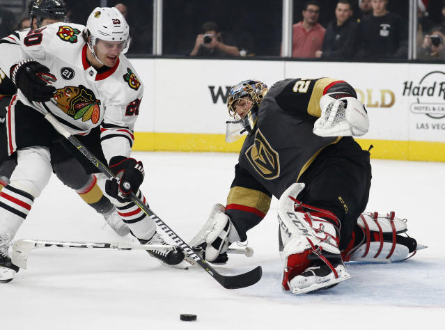 Chicago Blackhawks left wing Brandon Saad (20) attempts a shot against Vegas Golden Knights goaltender Marc-Andre Fleury (29) during the first period of an NHL hockey game Thursday, Dec. 6, 2018, in Las Vegas. (AP Photo/John Locher)