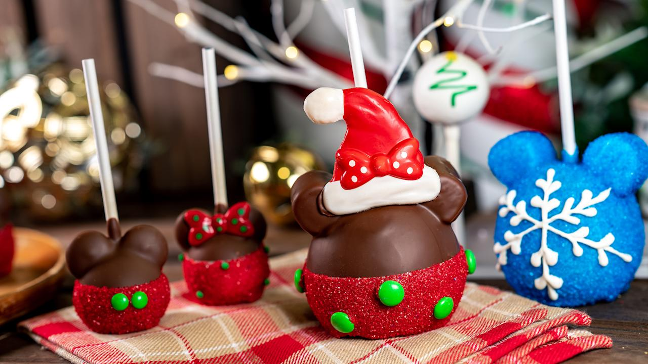 The Minnie Santa Apple is part of the limited-time holiday sweet treats at The Disneyland Resort in California. Available November 8 - January 6, this treat can be be purchased at select locations around the park. Photo: Supplied/Disney