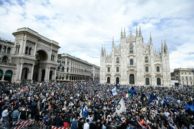Inter supporters celebrating in the Piazza del Duomo in Milan after their team were confirmed as champions