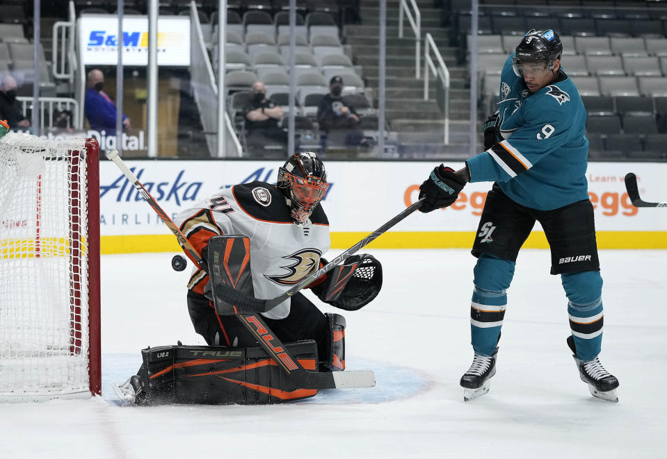 Anaheim Ducks goaltender Anthony Stolarz (41) blocks a shot by San Jose Sharks left wing Evander Kane (9) during the first period of an NHL hockey game Monday, April 12, 2021, in San Jose, Calif. (AP Photo/Tony Avelar)
