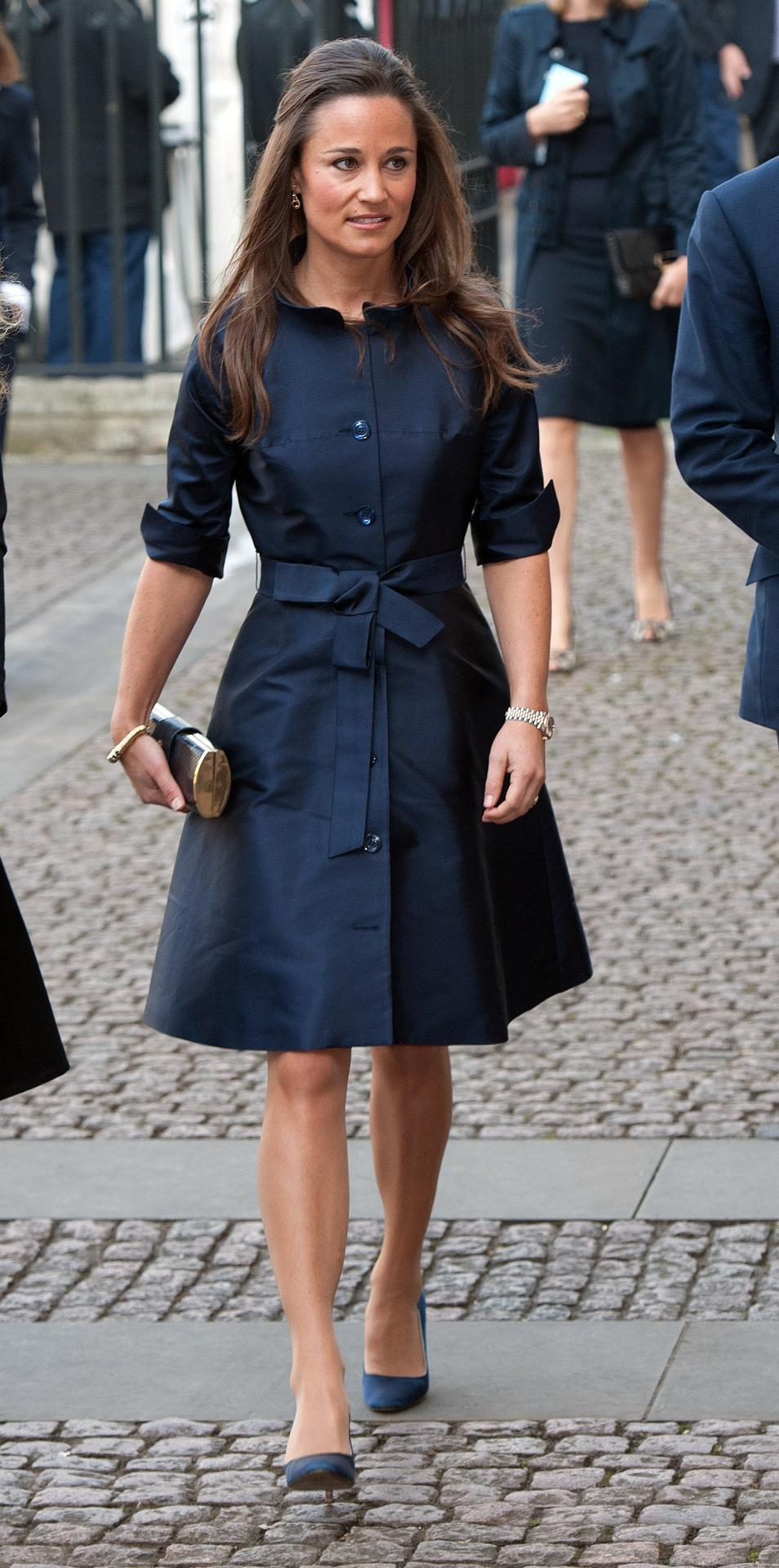 <p>This belted, navy blue Suzannah shirt dress was the perfect pick for Sir David Frost's memorial service in early 2014. <i>[Photo: PA Images]</i> </p>