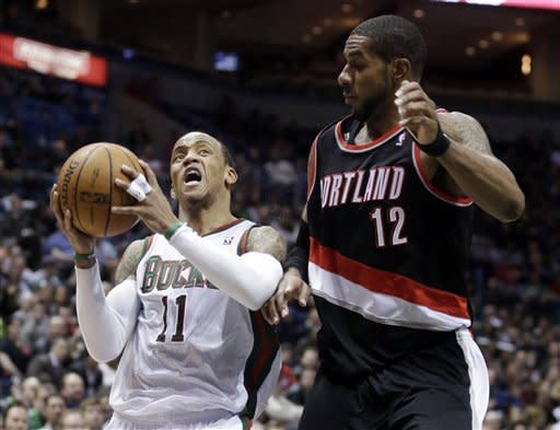 Milwaukee Bucks' Monta Ellis (11) drives past Portland Trail Blazers' LaMarcus Aldridge during the second half of an NBA basketball game Tuesday, March 19, 2013, in Milwaukee. The Bucks won 102-95. (AP Photo/Morry Gash)