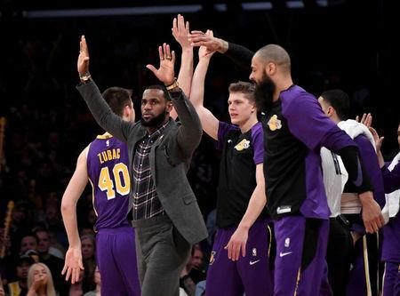 FILE PHOTO: Jan 9, 2019; Los Angeles, CA, USA; Los Angeles Lakers forward LeBron James (in the gray jacket) celebrates with teammates during the second half against the Detroit Pistons at the Staples Center. Mandatory Credit: Kirby Lee-USA TODAY Sports
