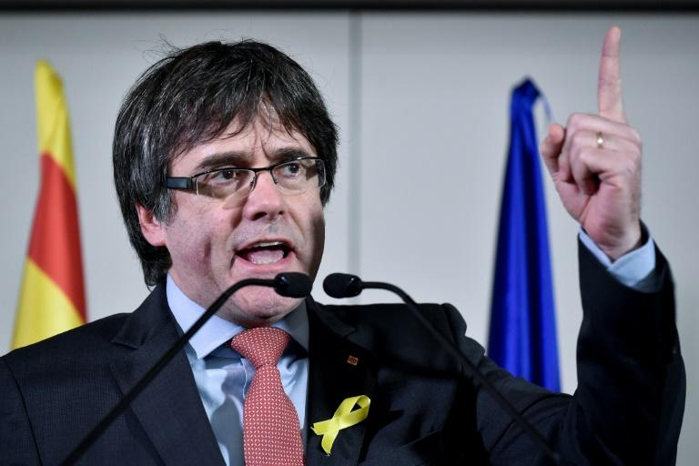 """We will not surrender to authoritarianism despite Madrid's threats,"" ousted Catalan leader Carles Puigdemont said"