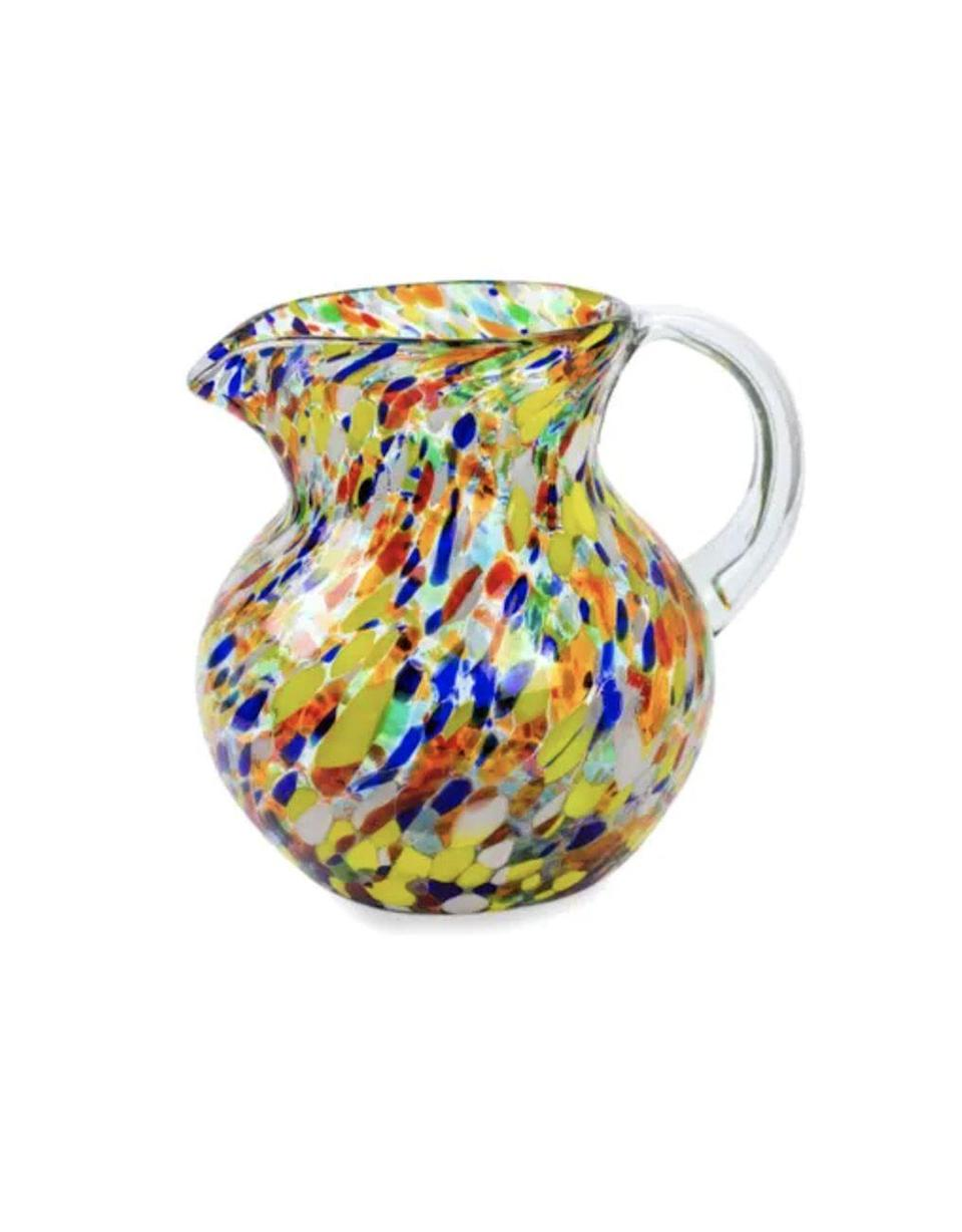 """<p><strong>UNICEF Market</strong></p><p>unicefusa.org</p><p><strong>$49.95</strong></p><p><a href=""""https://www.market.unicefusa.org/p/hand-blown-glass-pitcher-71-oz-multicolor/U13245/"""" rel=""""nofollow noopener"""" target=""""_blank"""" data-ylk=""""slk:Shop Now"""" class=""""link rapid-noclick-resp"""">Shop Now</a></p><p>Crafted by hand, this blown glass reveals a bright confetti pattern that'll brighten up any kitchen. Each purchase of this pitcher can provide 27 doses of measles vaccines to protect children.</p>"""