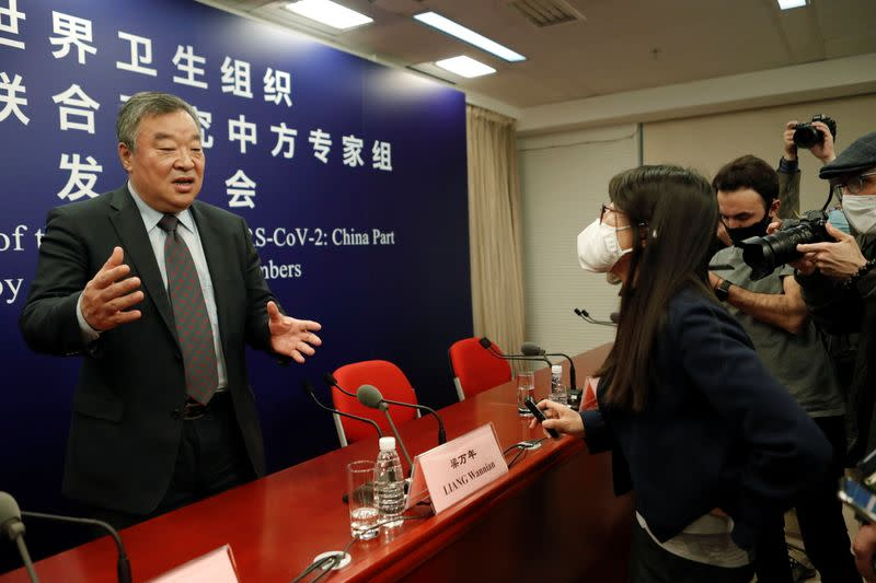 Liang Wannian at a news conference on the WHO-China joint study, in Beijing