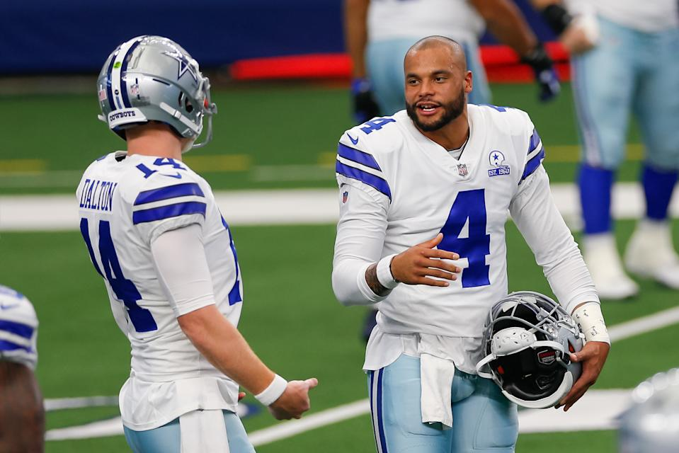 ARLINGTON, TX - OCTOBER 11: Dallas Cowboys Quarterback Dak Prescott (4) and Andy Dalton (14) talk prior to the NFL game between the New York Giants and Dallas Cowboys on October 11, 2020 at AT&T Stadium in Arlington, TX.  (Photo by Andrew Dieb/Icon Sportswire via Getty Images)