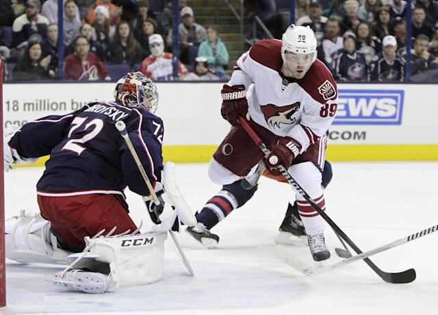 Columbus Blue Jackets' Sergei Bobrovsky, left, of Russia, makes a save against Phoenix Coyotes' Mikkel Boedker, of Denmark, during the overtime period of an NHL hockey game Tuesday, April 8, 2014, in Columbus, Ohio. The Blue Jackets defeated the Coyotes 4-3 in overtime. (AP Photo/Jay LaPrete)
