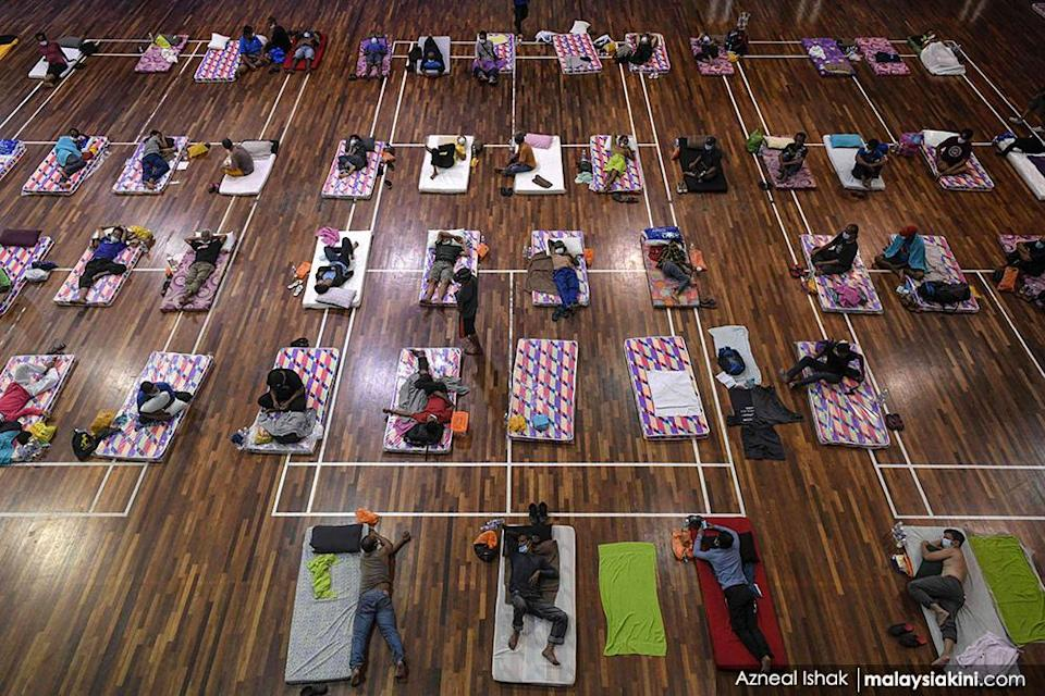 Homeless people practice social distancing on Apr 1, 2020, as they sit on their beds at a temporary shelter in KL during the MCO, which limited the activities of people in Malaysia as a preventive measure against the virus.<p><br></p>