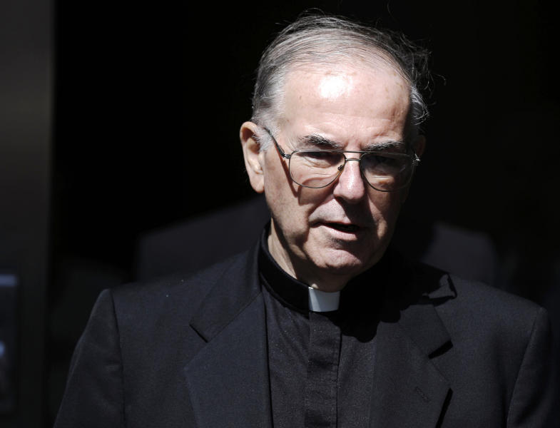 In this Sept. 7, 2012, file photo, Rev. Charles Engelhardt walks from the Criminal Justice Center in Philadelphia. Engelhardt is set to go on trial on charges he raped an altar boy in northeast Philadelphia in the late 1990s. Engelhardt has pleaded not guilty. (AP Photo/Matt Rourke, file)