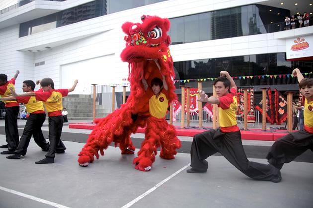 """The members of """"Tiger Crane"""" lion dance troupe in a competition performance. (Photo courtesy of J Team productions)"""