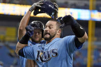 Tampa Bay Rays' Mike Zunino, front, celebrates his two-run home run off Boston Red Sox starting pitcher Garrett Richards with Brett Phillips during the second inning of a baseball game Wednesday, June 23, 2021, in St. Petersburg, Fla. (AP Photo/Chris O'Meara)