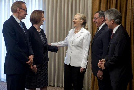 Australian Prime Minister Julia Gillard (2ndL), Australian Foreign Minister Bob Carr (L) and Australian Minister of Defense Stephen Smith (R) greet US Secretary of State Hillary Clinton (C) and US Secretary of Defense Leon Panetta (2ndR) prior to their Australia-United States Ministerial meetings in Perth