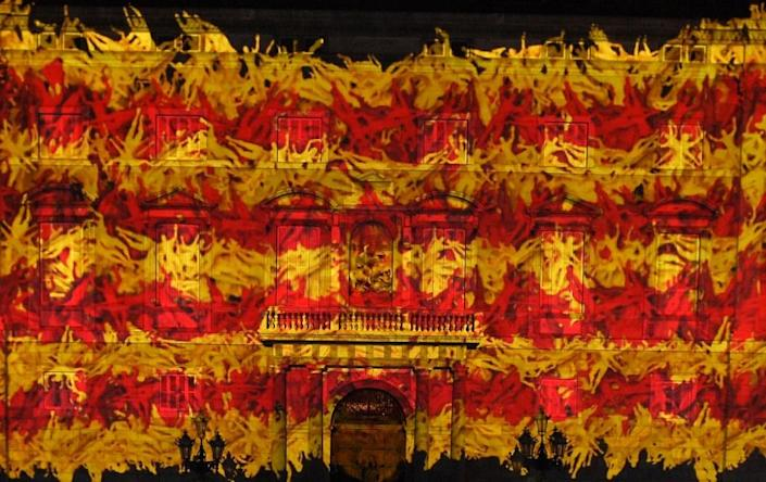A Catalan flag is projected on the facade of Palau de La Generalitat, the Catalan government headquarters, during the ceremony marking Catalonia National Day, or Diada, in Barcelona, on September 9, 2015 (AFP Photo/Lluis Gene)