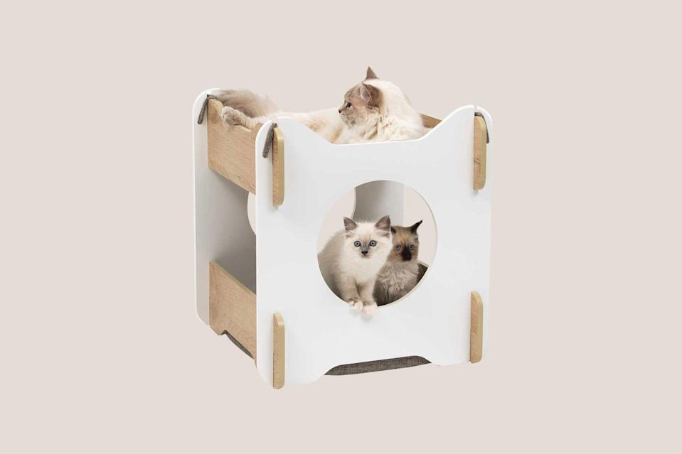 """<p>The only thing better than a clean-lined cat bed enclosure is one with a built-in hammock. """"The Vesper Cabana has a snug hideout with a soft, padded cushion at the bottom, and a relaxing hammock with a 360-degree view on top,"""" explains Hall. """"Plus, the hideout has multiple entrances allowing cats to enter and exit from any side.""""</p> <p><strong><em>Shop Now:</em></strong> <em>Catit Vesper Cabana, $60</em><em>, </em><a href=""""https://usa.catit.com/shop/vesper-cabana/"""" rel=""""nofollow noopener"""" target=""""_blank"""" data-ylk=""""slk:usa.catit.com"""" class=""""link rapid-noclick-resp""""><em>usa.catit.com</em></a><em>. </em></p>"""