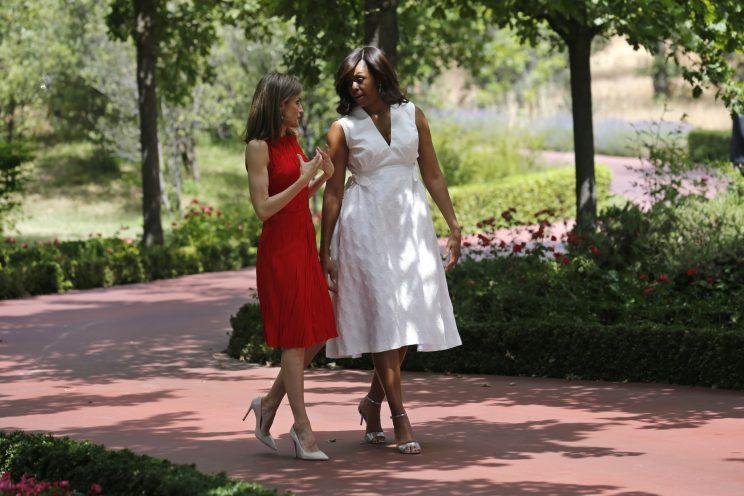 First lady Michelle Obama walks with Spain's Queen Letizia, left. in the gardens of the Zarzuela Palace in Madrid, Spain, Thursday June 30, 2016. Michelle Obama is in Spain on the final leg of a three-nation tour to promote her global girls' education initiative. (Francisco Gomez, Casa Real Pool Photo via AP)