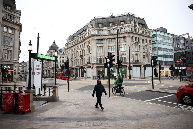 People walk through Oxford Circus as shops remain closed under Tier 4 restrictions, amid the coronavirus disease (COVID-19) outbreak, in London