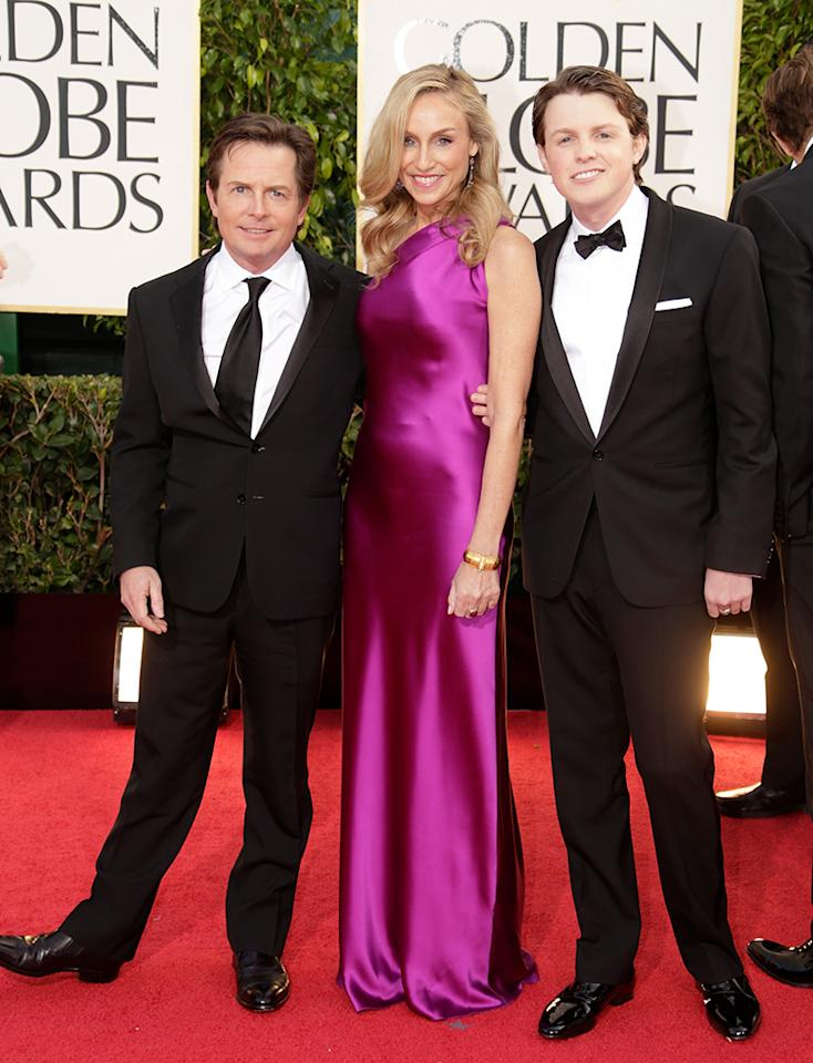 <p>Michael J. Fox and actress-wife Tracy Pollan accompany son Sam to the ceremony, where he played Mr. Golden Globe opposite Francesca Eastwood. (Photo: Jeff Vespa/WireImage) </p>