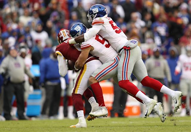 <p>Mark Sanchez #6 of the Washington Redskins is sacked by outside linebacker Olivier Vernon #54 and linebacker Lorenzo Carter #59 of the New York Giants in the second quarter at FedExField on December 9, 2018 in Landover, Maryland. (Photo by Patrick Smith/Getty Images) </p>