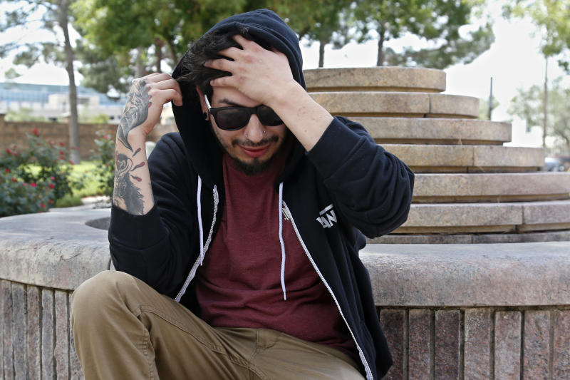 Daniel Munoz talks about his experience being injured in Saturday's shooting incident during an interview in a park in Odessa, Texas, Sunday, Sept. 1, 2019. (AP Photo/Sue Ogrocki)