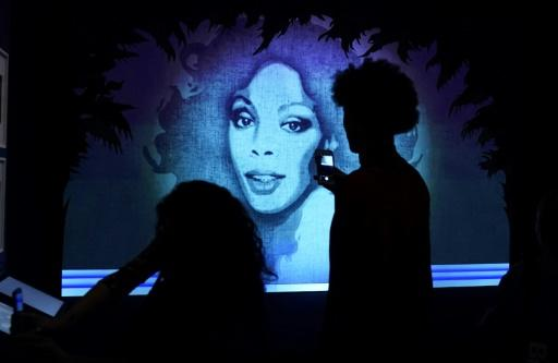 A portrait of disco icon Donna Summer glows at the Brooklyn Museum's Studio 54: Night Magic exhibit