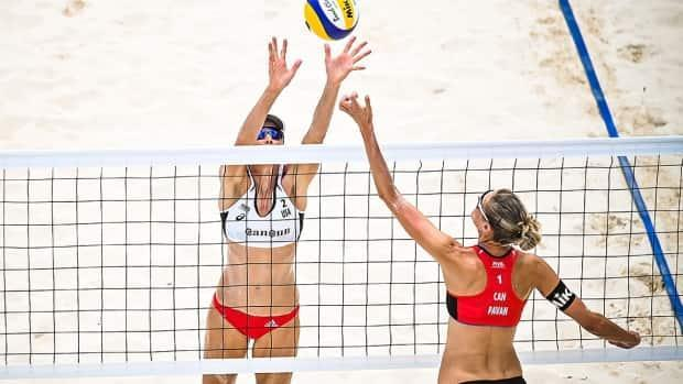 American Alix Klineman, left, was dominant at the net in the second and final set Sunday, partnering with April Ross for a 21-16, 21-15 sweep of Canadians Sarah Pavan, right, and Melissa Humana-Paredes in a bronze-medal match in Cancun, Mexico. (Submitted by FIVB - image credit)