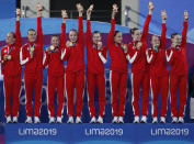 Canada's artistic swimming team celebrates after receiving their gold medals in the finals of team competition free artistic swimming at the Pan American Games in Lima, Peru, Wednesday, July 31, 2019. (AP Photo/Moises Castillo)