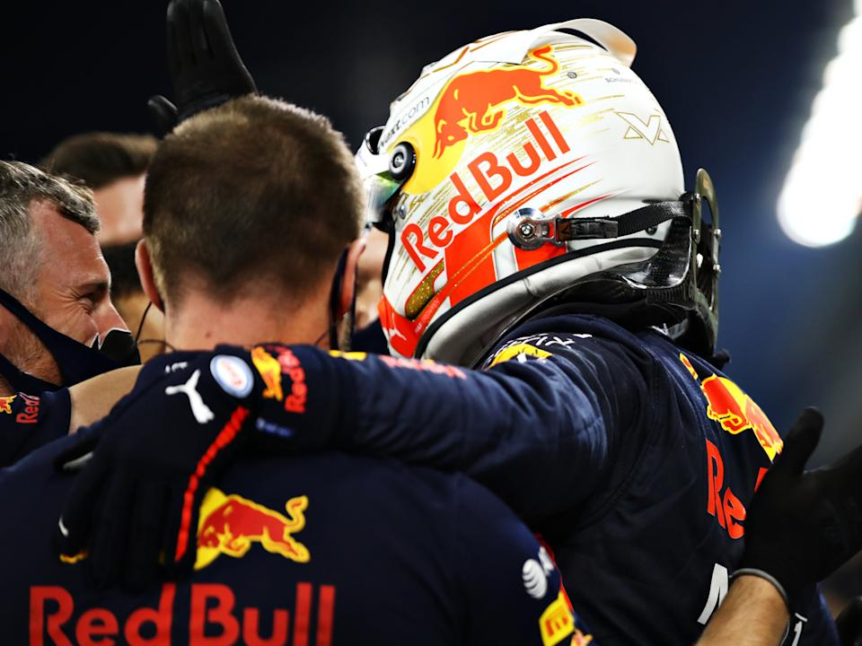 Verstappen and members of his Red Bull team celebrate their pole positionGetty Images