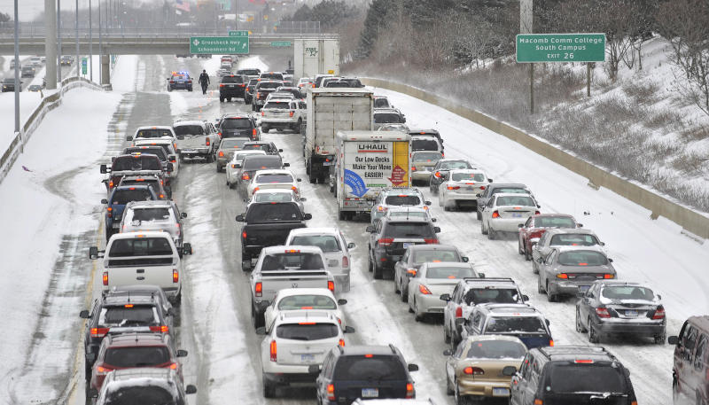 The westbound Interstate 696 is closed at Groesbeck Highway due to numerous accidents, Sunday, Jan. 26, 2014, on I-696 in Roseville, Mich. (AP Photo/Detroit News, Robin Buckson) DETROIT FREE PRESS OUT; HUFFINGTON POST OUT.