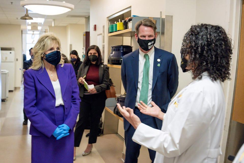 National Cancer Institute Director Ned Sharpless  and first lady Jill Biden are briefed by a research staff member at the Massey Cancer Center in Richmond, Va., on Feb. 24.