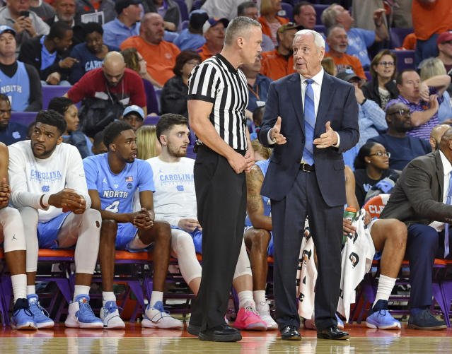 North Carolina coach Roy Williams discusses a call with an official during the first half of the team's NCAA college basketball game against Clemson on Saturday, March 2, 2019, in Clemson, S.C. (AP Photo/Richard Shiro)