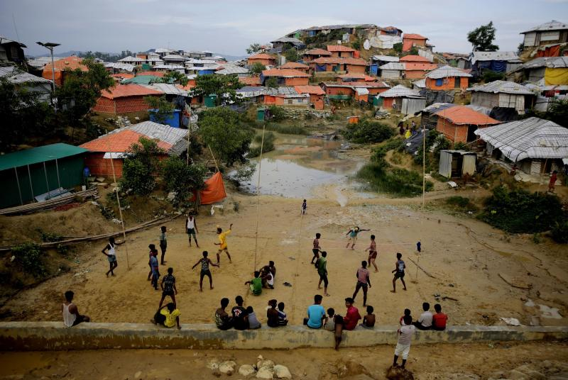 FILE- In this Aug. 27, 2018 file photo, Rohingya refugees play at Balukhali Refugee Camp in Bangladesh. Officials from the U.N. refugee agency and Bangladesh's government say few Muslim Rohingya refugees have responded to plans for their repatriation to Myanmar, and all who did say they don't want to go back. (AP Photo/Altaf Qadri, File)
