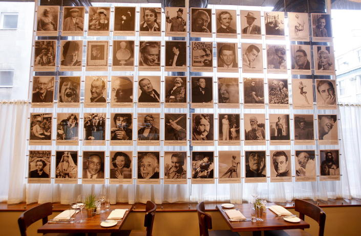 Photographs showing all the people who appeared on the cover of Sgt Pepper Album hang on a wall in the Blakes restaurant at the the newly opened Hard Days Night Hotel in Liverpool, northern England February 1, 2008. The four-star, 110-room Beatles-themed hotel opened its doors to the public and is only a stone's throw away from the site of the famous Cavern Club. REUTERS/Phil Noble