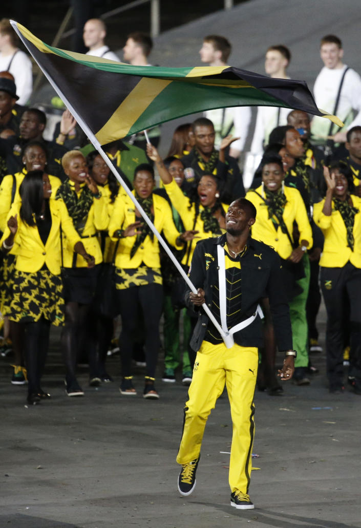 <b>Best</b> <br> On first glance the Jamaican team's bright yellow pants and blazers might seem over-the-top, but paired with understated black bottoms and a stylish patterned scarf, it pulls together the neon color seamlessly.