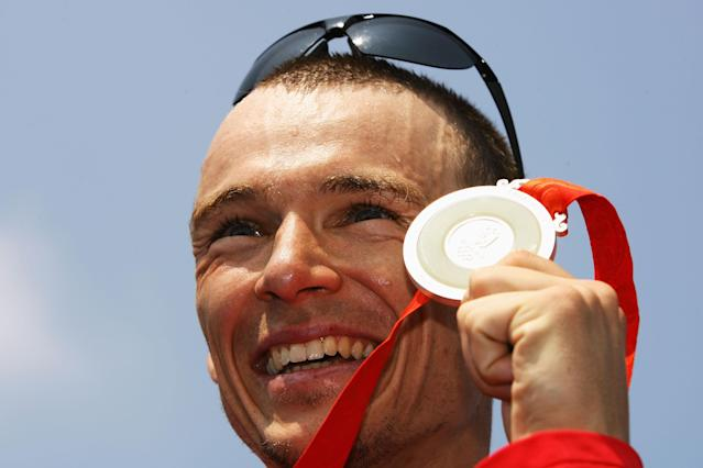 BEIJING - AUGUST 19: Silver medalist Simon Whitfield of Canada poses after the Mens Triathlon Final at the Triathlon Venue on Day 11 of the Beijing 2008 Olympic Games on August 19, 2008 in Beijing, China. (Photo by Adam Pretty/Getty Images)