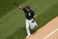 Chicago White Sox's Adam Eaton (12) celebrates while rounding the bases after hitting a two-run home run during the fifth inning of a baseball game against the Kansas City Royals Sunday, May 16, 2021, in Chicago. (AP Photo/Paul Beaty)